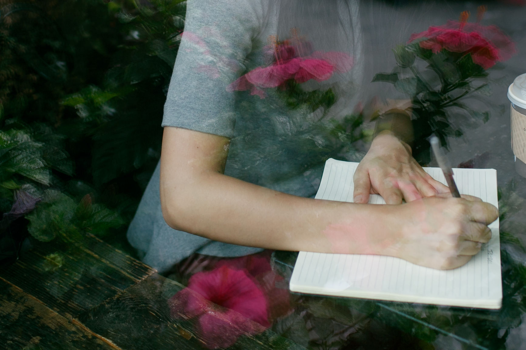Woman writes in her notebook
