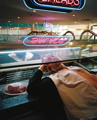 James J. Robinson photographs a man in a canteen