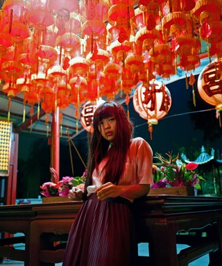 James J. Robinson shoots a girl surrounded by lanterns