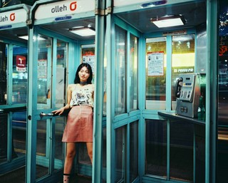 James J. Robinson photographs woman in a phone box