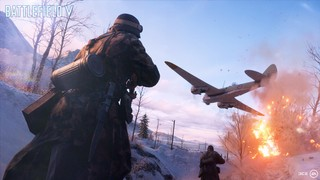 A bomber flies low over a soldier's head on a snowbound battlefield, chased by a trail of explosions in its wake.
