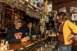 Patrons laughing at Elliott Street Pub