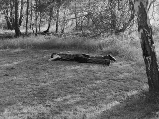 yann faucher photographs a model lying in the woods