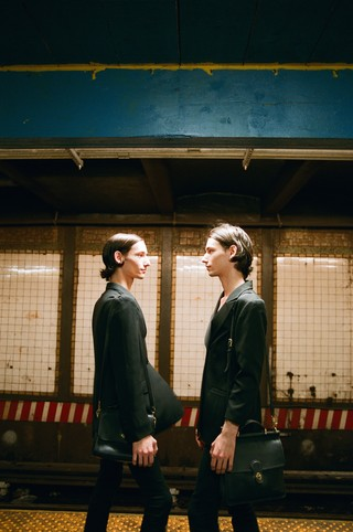 TWINS on the subway photographed by sabrina santiago