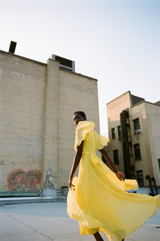 a model on the roof in new york photographed by sabrina santiago