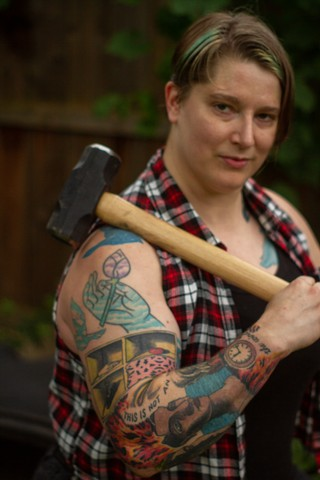 A person holding some kind of hammer