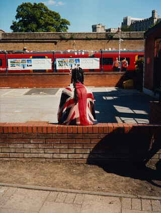 maxwell tomlinson photographs a woman wearing a union jack flag