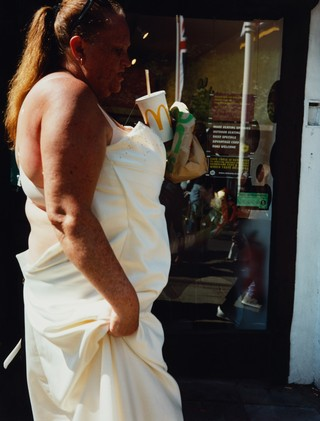 maxwell tomlinson photographs a woman in a white dress with mcdonalds