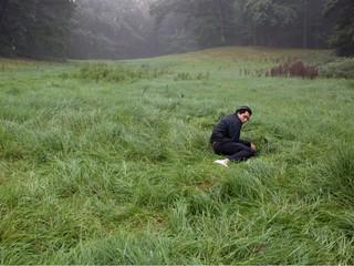 david uzochukwu lying in a field
