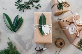 Top a gift with twine and a leaf or branch