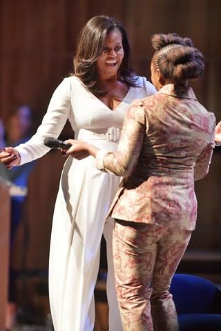 Michelle Obama greeting Chimamanda Ngozi Adichie