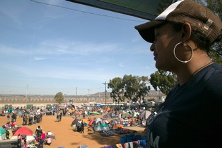 Woman from the migrant caravan looks over a camp in Tijuana, Mexico