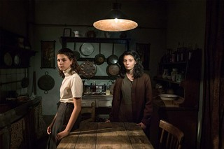Lila and Elena, teenage age, in the kitchen