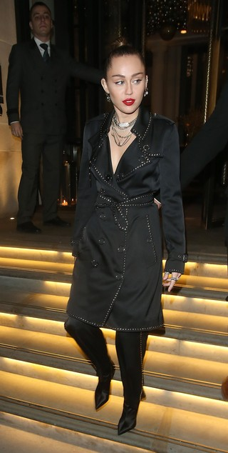 1544452941835-Miley-Cyrus-wearing-Burberry-at-a-party-to-celebrate-the-launch-of-the-Vivienne-Westwood-and-Burberry-collaboration-collection