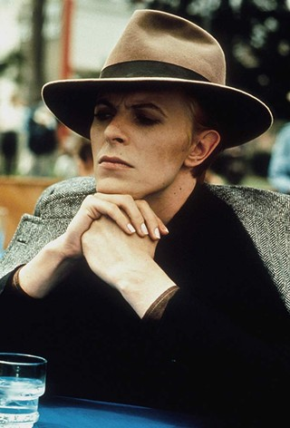 David Bowie with a hat on in The Man Who Fell To Earth by Nicolas Roeg