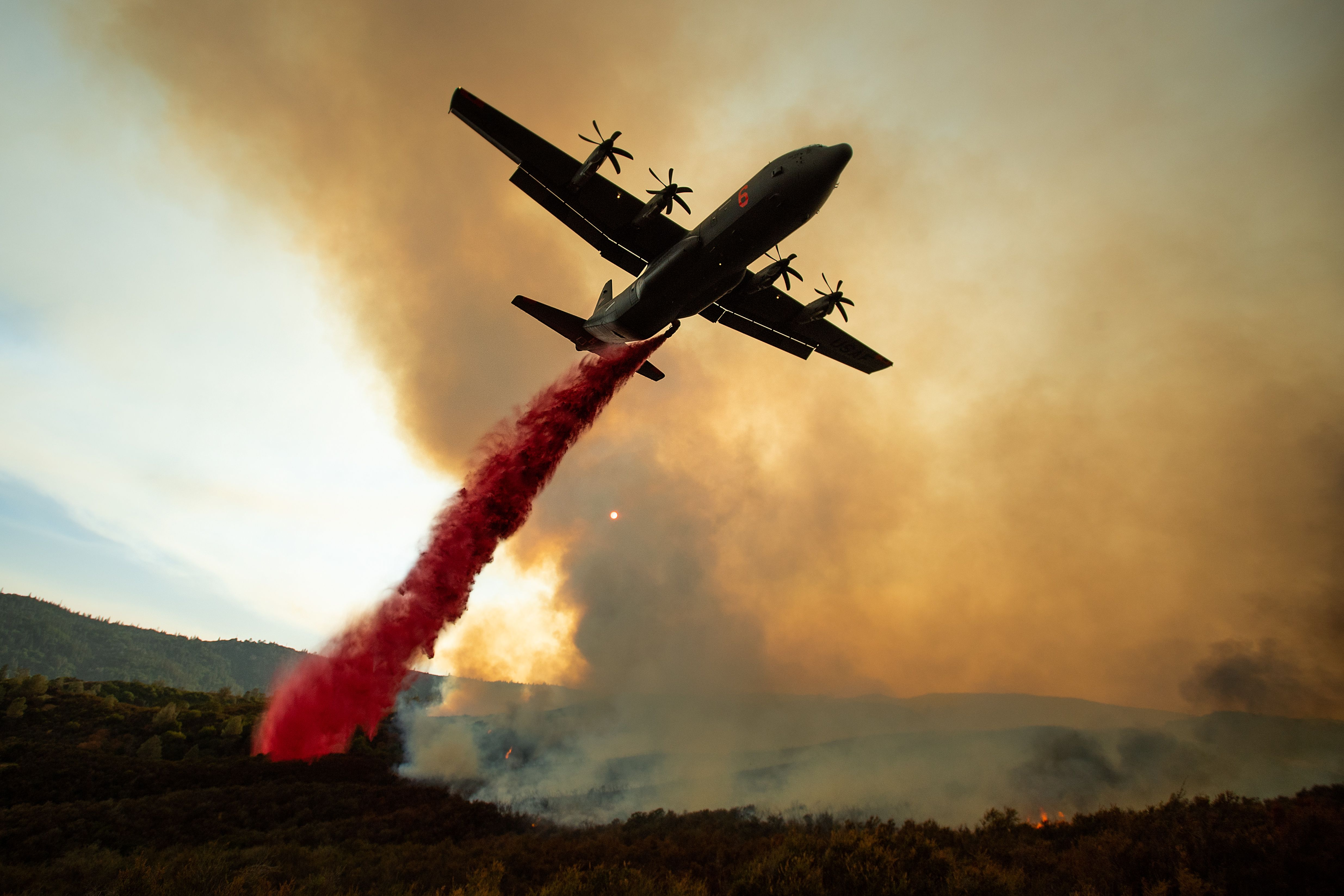 Air air tanker dropping retardant on part of the Mendocino Complex Fire.