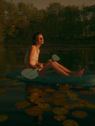 zachary chick photographs a girl paddling in a pond