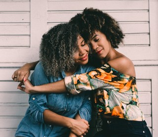 Female friends hugging each other