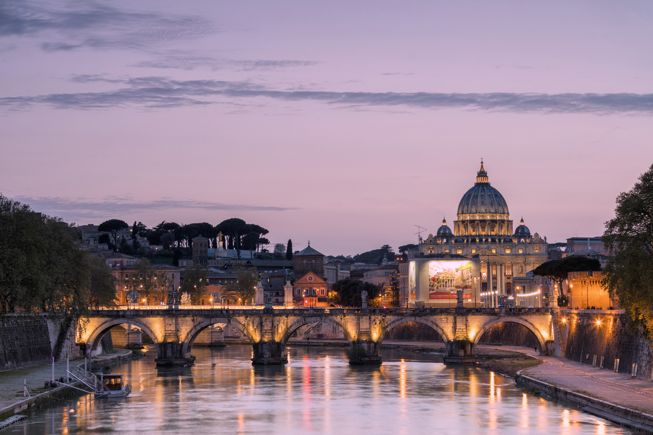 Dusk on the Tiber River in Rome. Photo by Getty Images / Roberto Moiola Sysaworld