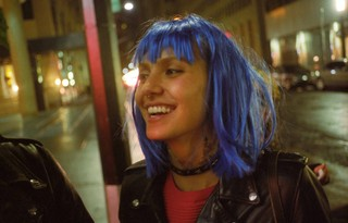 a girl wearing a blue wig