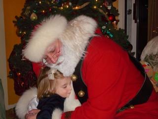 santa father christmas hug little girl