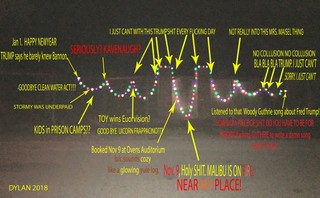 A photo of Bob Dylan's Christmas lights with notes over the top of the strings' highs and lows.