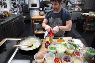 ken oringer prepping ingredients for fideos