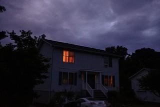House in the dark an orange window