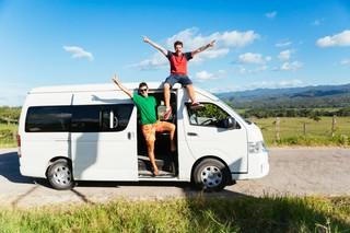Guys on vacation in a van. Photo by Alejandro Moreno De Carlos Stocksy