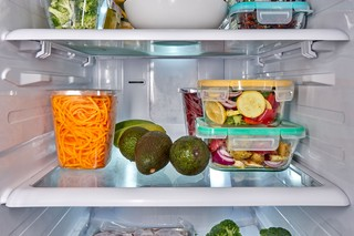 Refrigerator full of food. Photo by Suzanne Clements Stocksy