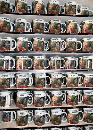 A rack of Dolly Parton-branded mugs