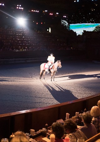 A rider on horseback at the Dolly Parton's Stampede dinner show