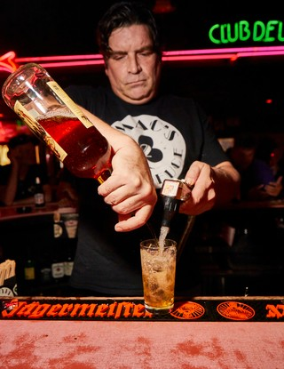 Bartender pouring a drink at Mac's Club Deuce