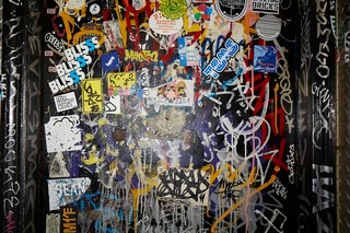 Bathroom wall at Mac's Club Deuce