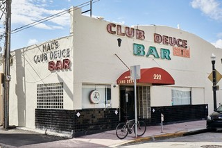 Mac's Club Deuce exterior in the daylight
