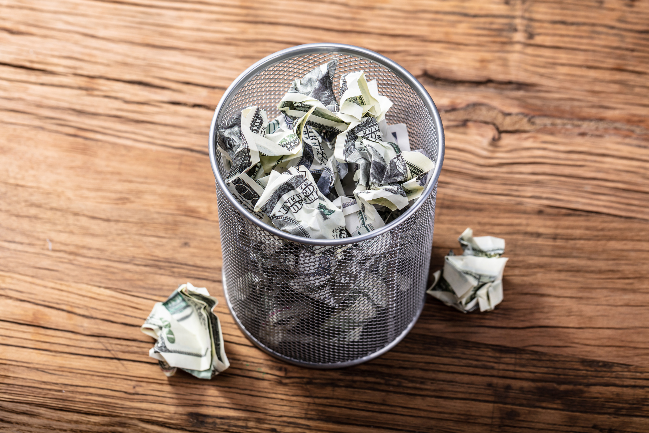 Getty Images trash can with money.