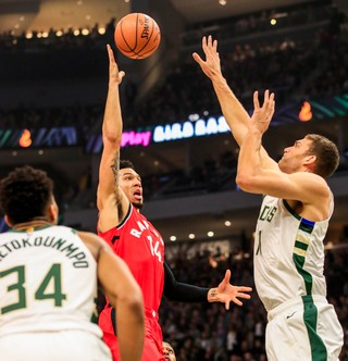 Toronto Raptor Danny Green puts up a shot over Brook Lopez of the Milwaukee Bucks.