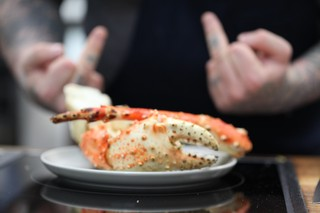jamie bissonnette posing with king crab claws