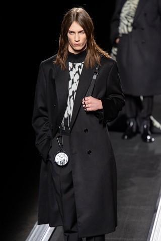 Freek Iven rides the catwalk conveybelt at Dior