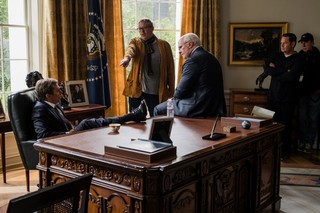 Director Adam McKay (center) with Christian Bale (right) and Sam Rockwell (seated) on the set of 'VICE.' Images courtesy of Annapurna Pictures