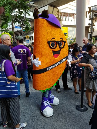 Person in taco suit at the opening of Taco Bell in Bangkok