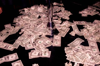 dollar bills on a floor