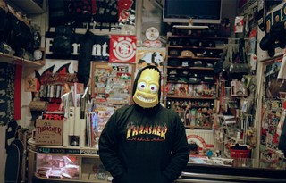man-in-thrasher-hoodie-ride-all-day-skateboard-shop