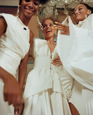 From left: Tami wears dress by OFF-WHITE c/o VIRGIL ABLOH, earrings by KENNETH JAY LANE; Hiandra wears top and skirt by FENDI, earrings by FALLON; Lineisy wears top and skirt by PYER MOSS.