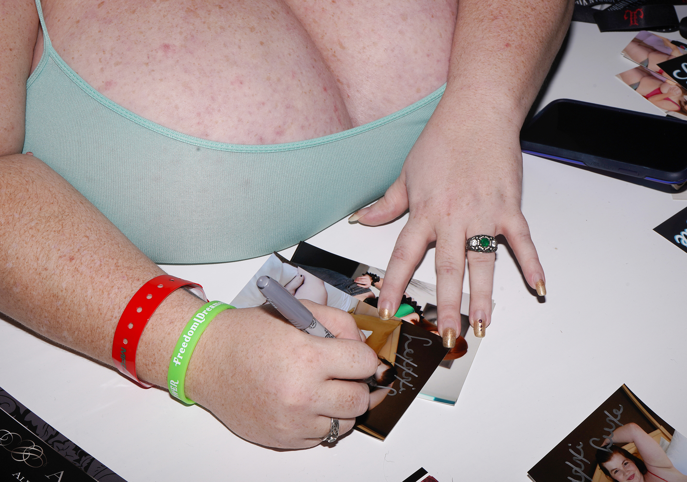 The hands of a BBW porn performer as she signs a photo of herself
