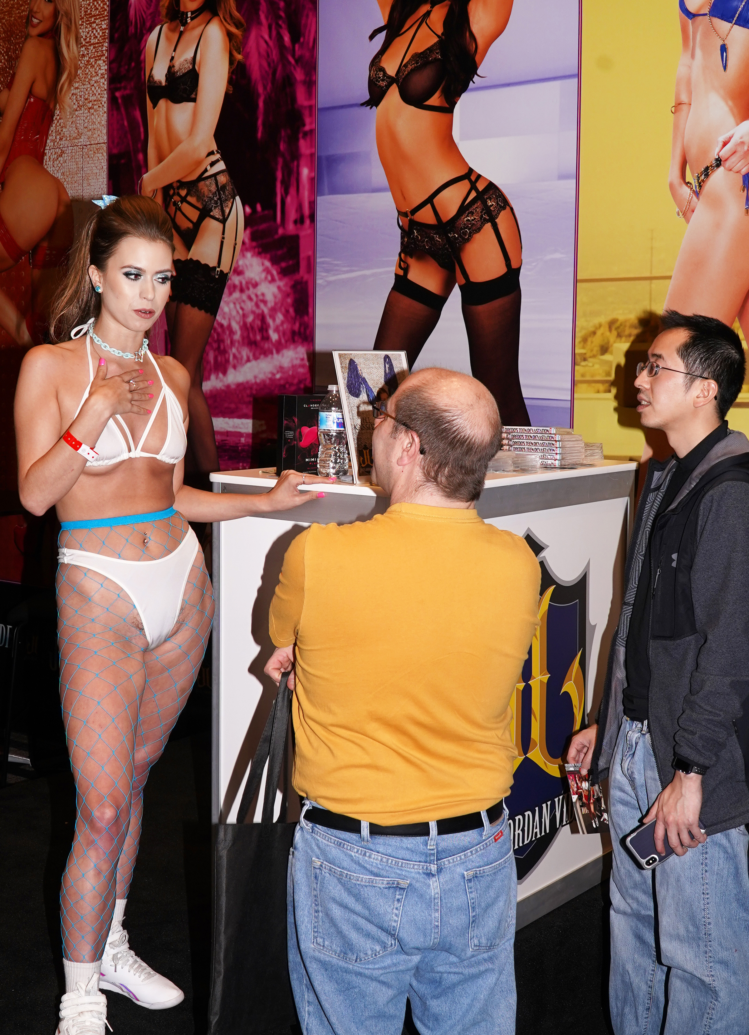 Two fans chatting to a porn performer