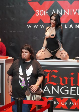 A fan posing for a photo with a porn performer