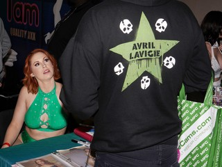 A woman talking to a man in an Avril Lavigne hoodie