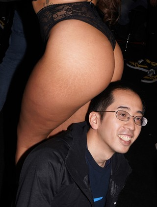 A fan posing with a porn performer's butt