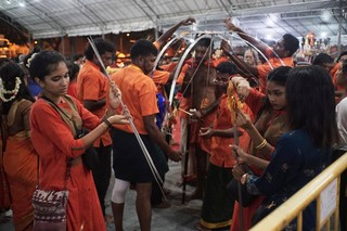 thaipusam family removing spikes